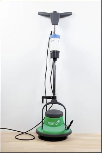 Osmo Golvmaskin med vätskebehållare och doseringsknapp för rengöringsmedel.